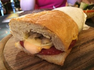 Salami, mushroom and mozzarella sandwich with cocktail sauce