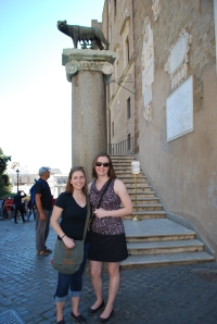 Standing with the symbol of Rome.